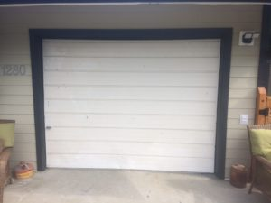 Gibsons Garage door before